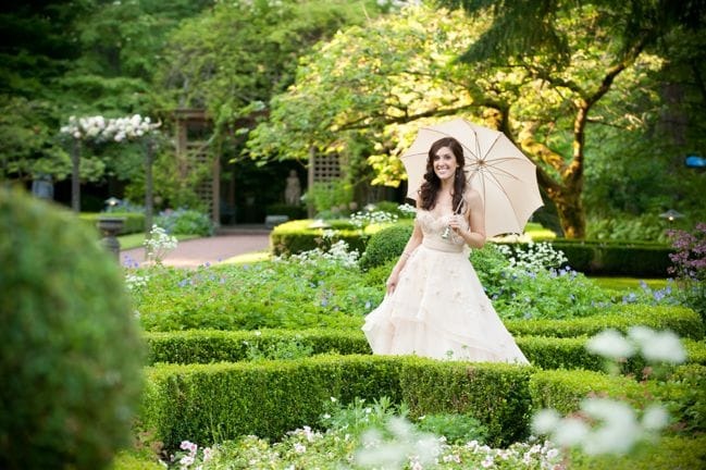 bride walking in garden