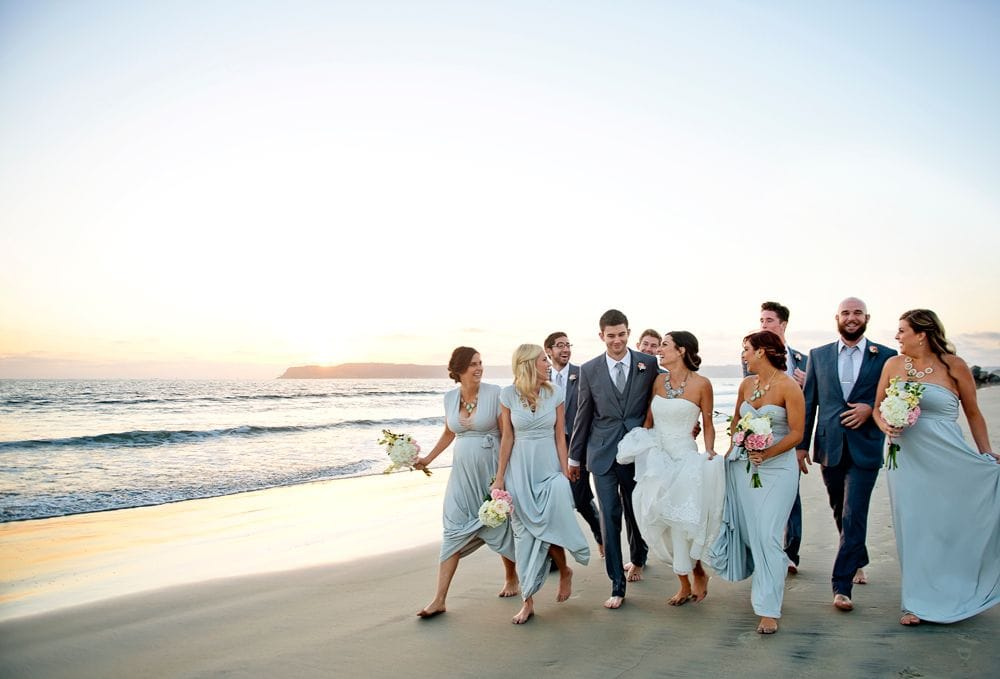 bridal party walking on the beach
