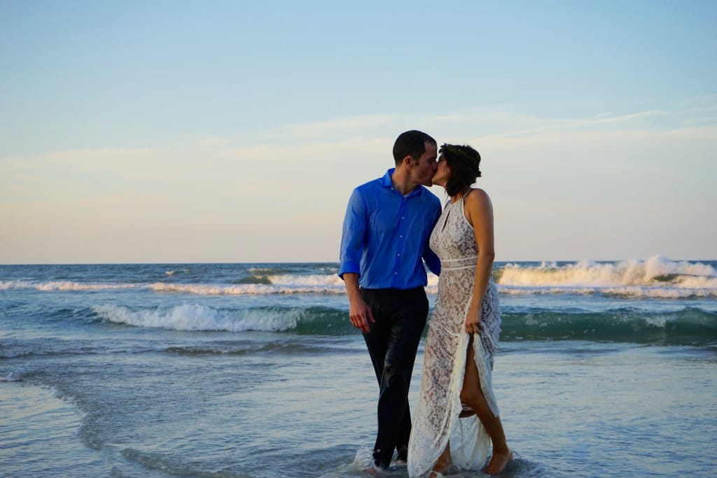 newlywed kiss on the beach