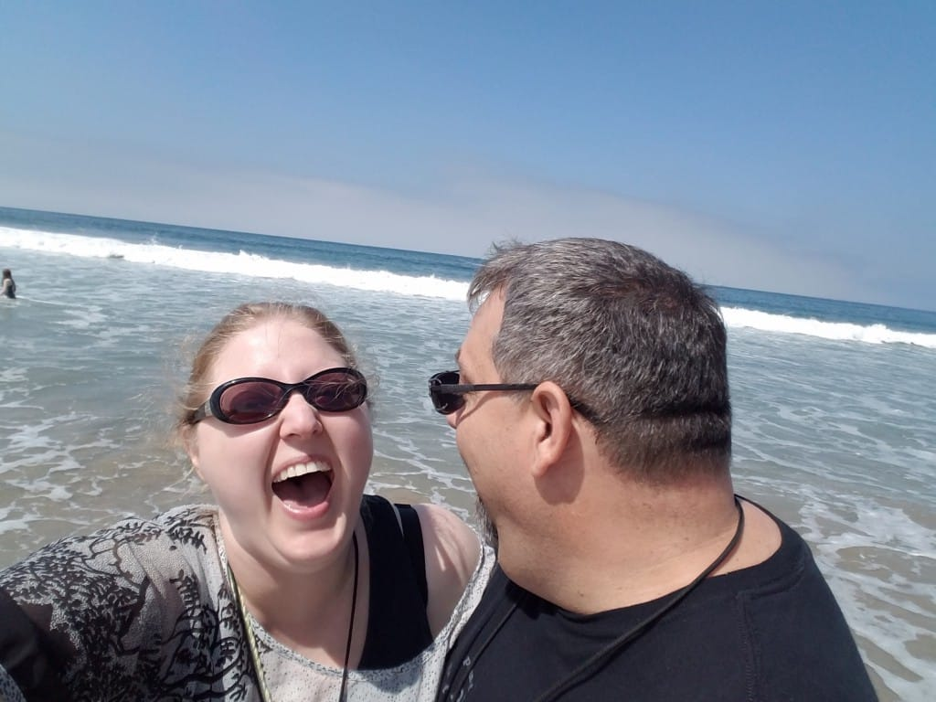 One of our favorite pictures together.  This was an amazing day at Venice Beach.  We were walking along the water taking pictures together and this rogue wave caught us off guard.  We were soaked from the waist down (we were only standing in water up to our ankles!).