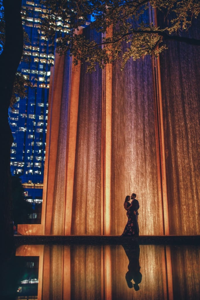 couple embracing at gerald D. hines waterwall park