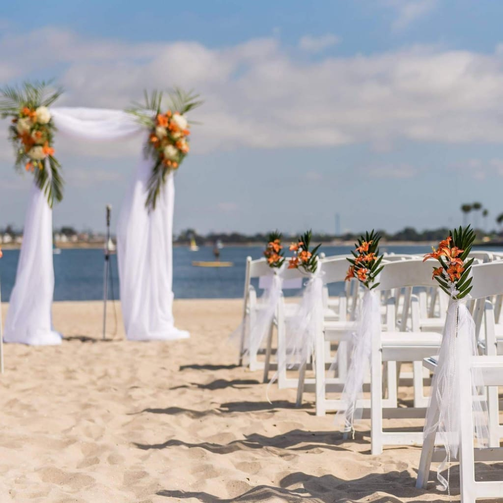 wedding ceremony setup on the beach at catamaran resort hotel and spa in san diego