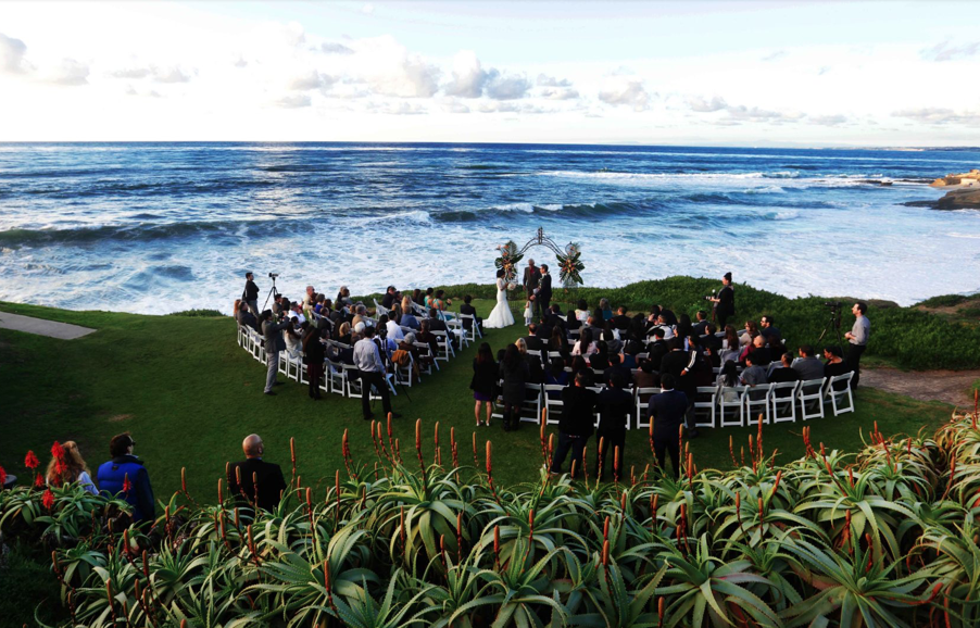 wedding on the grass covered bluff at the cuvier club in san diego