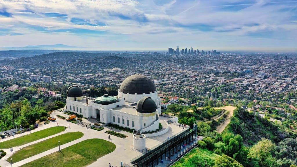 griffith observatory with the los angeles, california skyline in the background