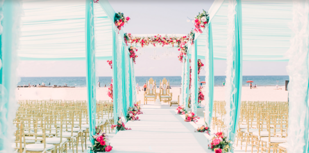 wedding ceremony set up on the beach at the hotel del coronado in san diego