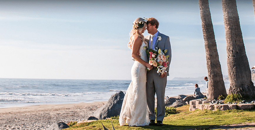 bride and groom embracing on wedding day at l'auberge del mar in san diego