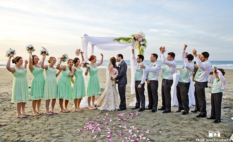 bride, groom, and wedding party on the beach at la jolla shores hotel in san diego