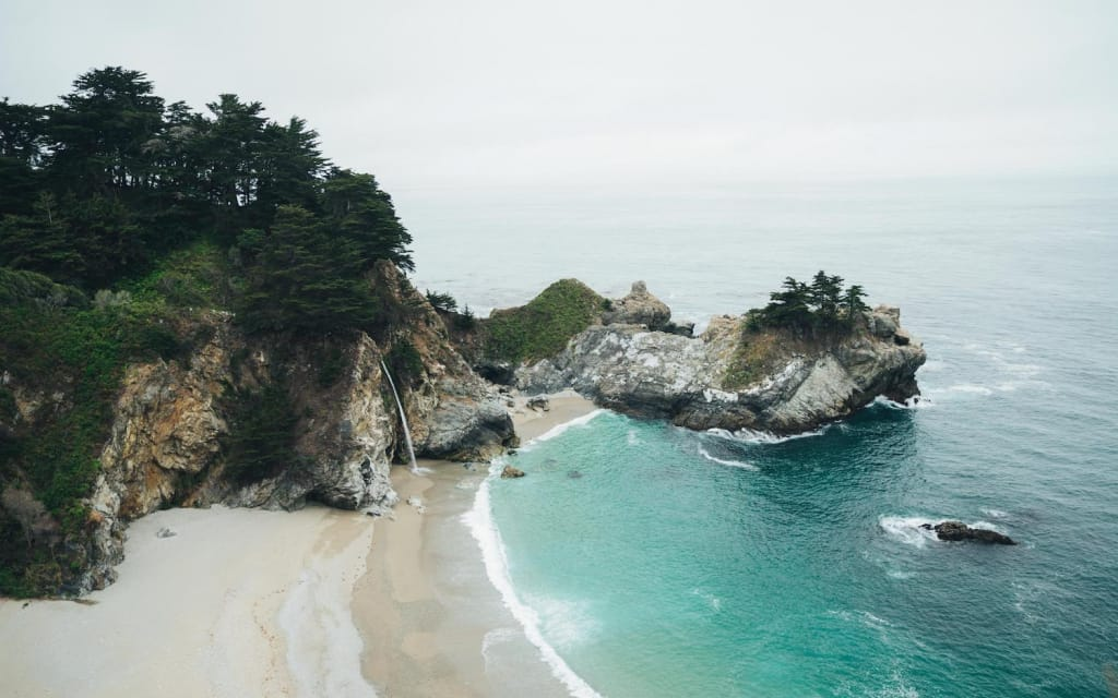 mcway falls on an overcast day at pfeiffer big sur state park in california