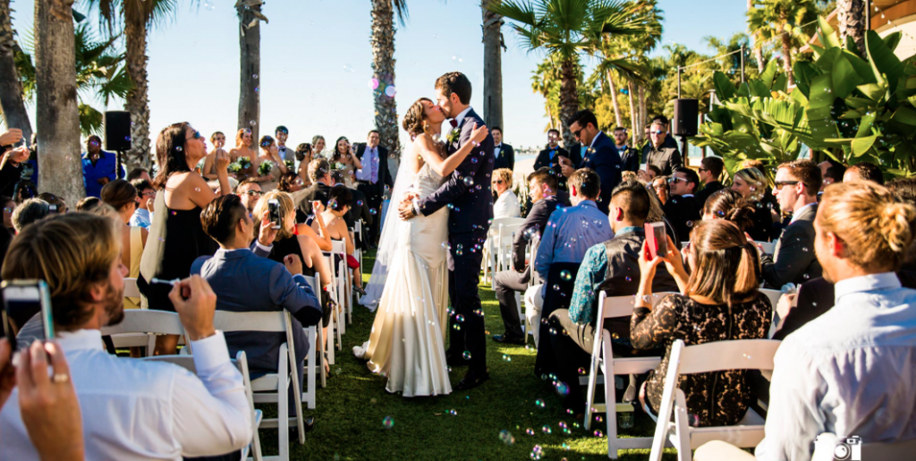 couple kissing after exchanging their vows at an outdoor wedding ceremony at paradise point resort & spa