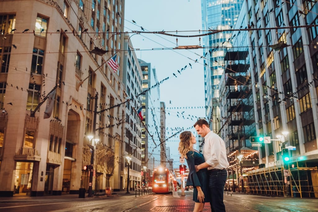 couple embracing on main street in houston