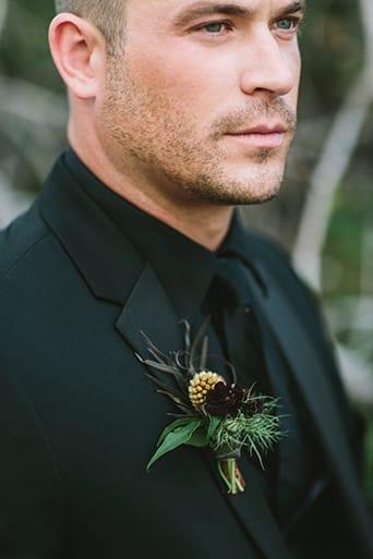 all black fall wedding attire groom
