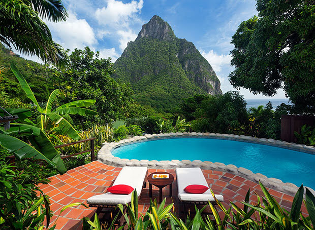 two white lounge chairs by a private pool looking out on Petit Piton at a villa at Stonefield Estate Resort in St. Lucia