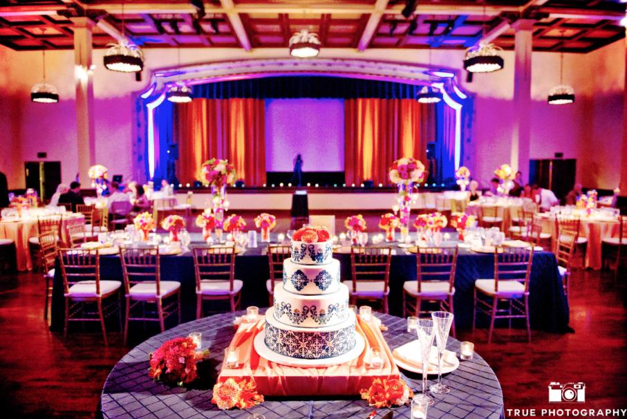 wedding cake and table settings in the grand ballroom at the prado at balboa park