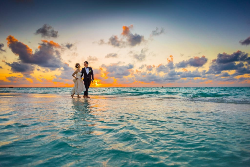 Who pays for the wedding: Bride and groom on the beach