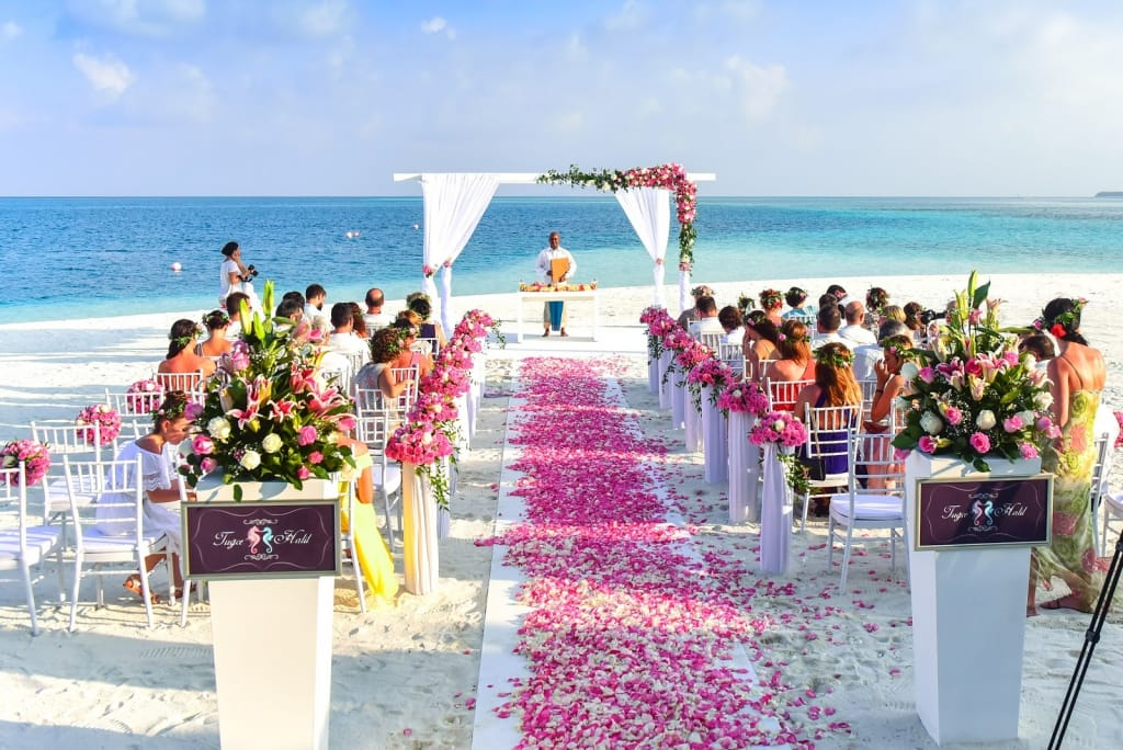Aisle view of a beach wedding