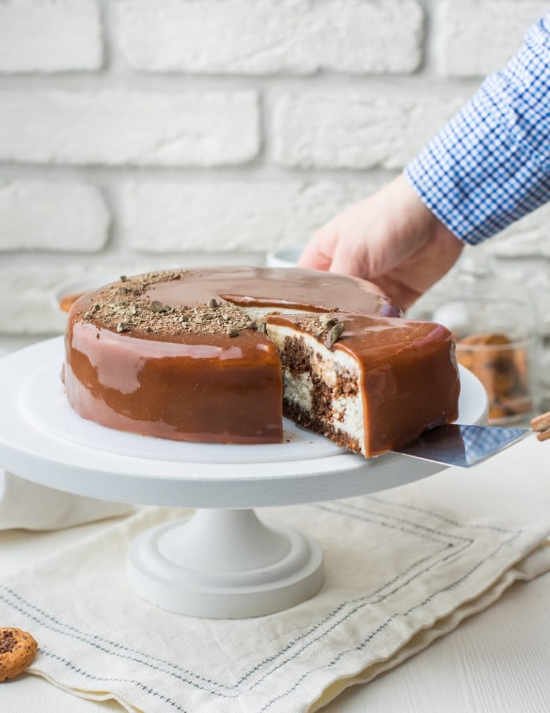 baked marble cake with chocolate icing: slicing the cake