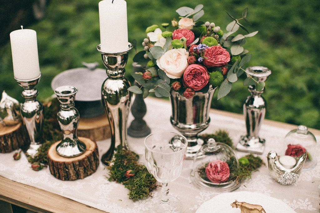 Silver candlesticks and berry decor