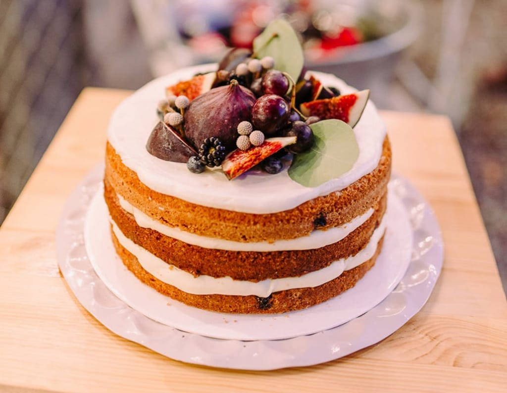 Naked wedding cake with figs and berries