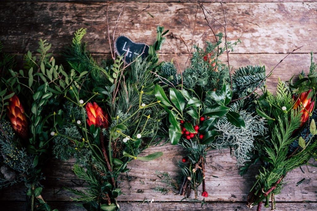 green and red christmas bouquet arrangements