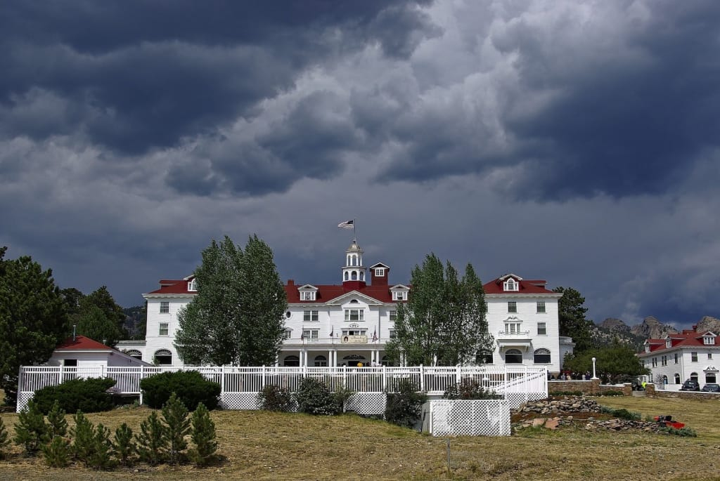 the stanley hotel in colorado under a stormy sky