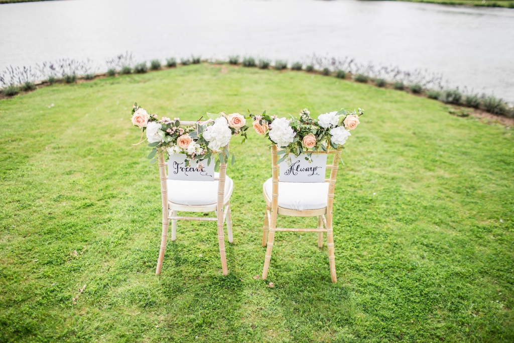 two wedding chairs labeled
