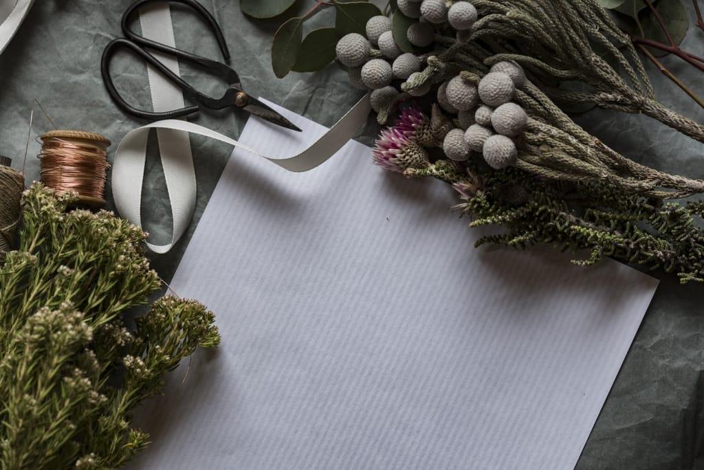 diy winter wedding flowers setup with scissors and ribbon