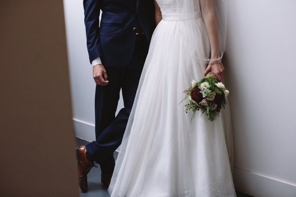 bride holding bouquet next to groom