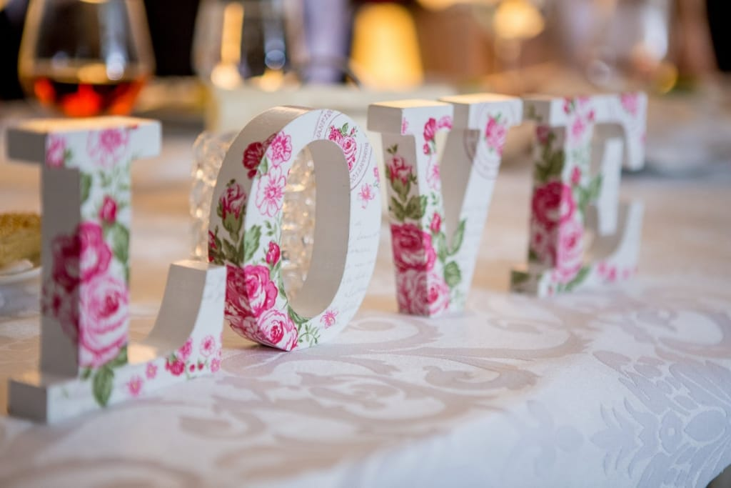 Floral wood block letters spelling out the word Love