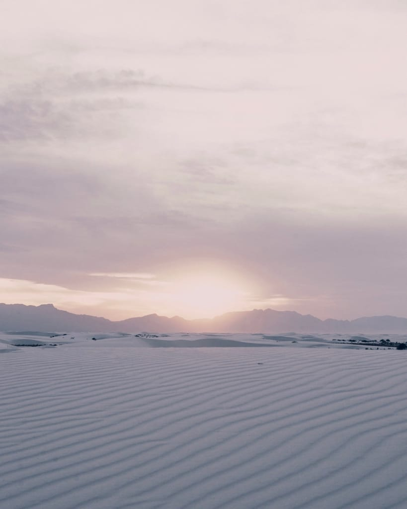white sands and mountains under a lavender sky as proposal setting