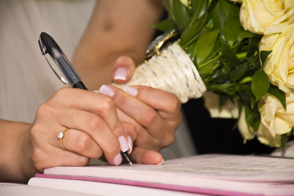 married woman writing on paper