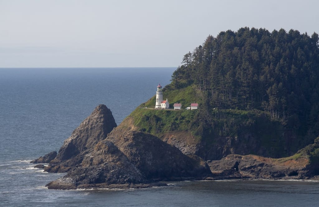 heceta head lighthouse on a cliff along oregon coast