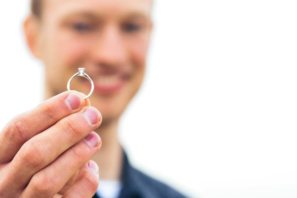 Close-up of man holding a diamond engagement ring