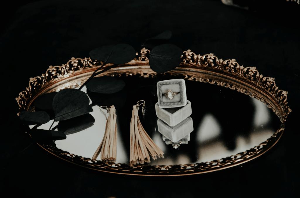 Diamond engagement ring on mirror tray