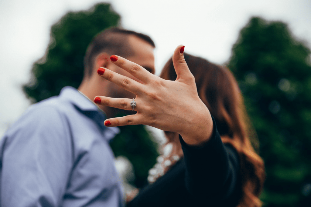 How much to spend on engagement ring: Woman showing off her ring