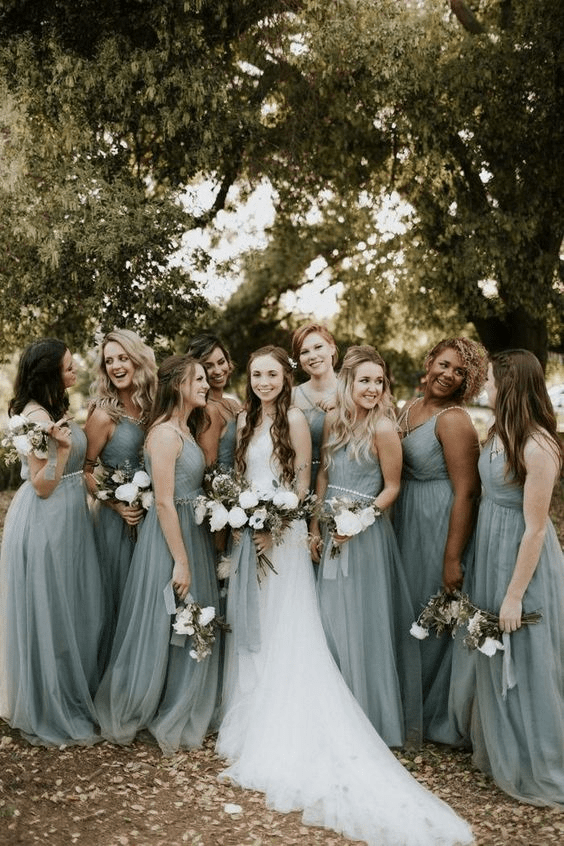 Bridal party in sage green spring wedding colors