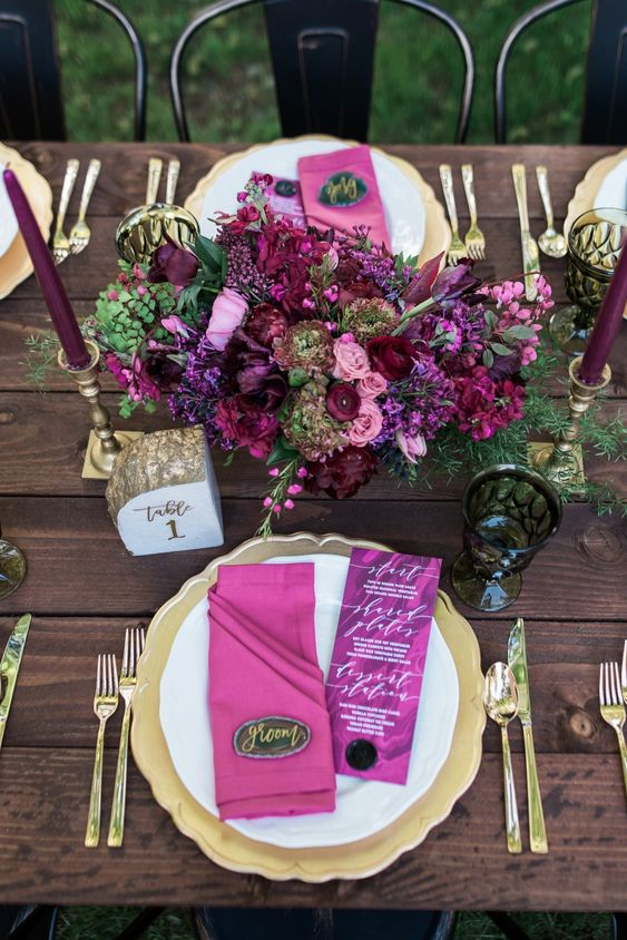 Rich berry hues and gold wedding colors