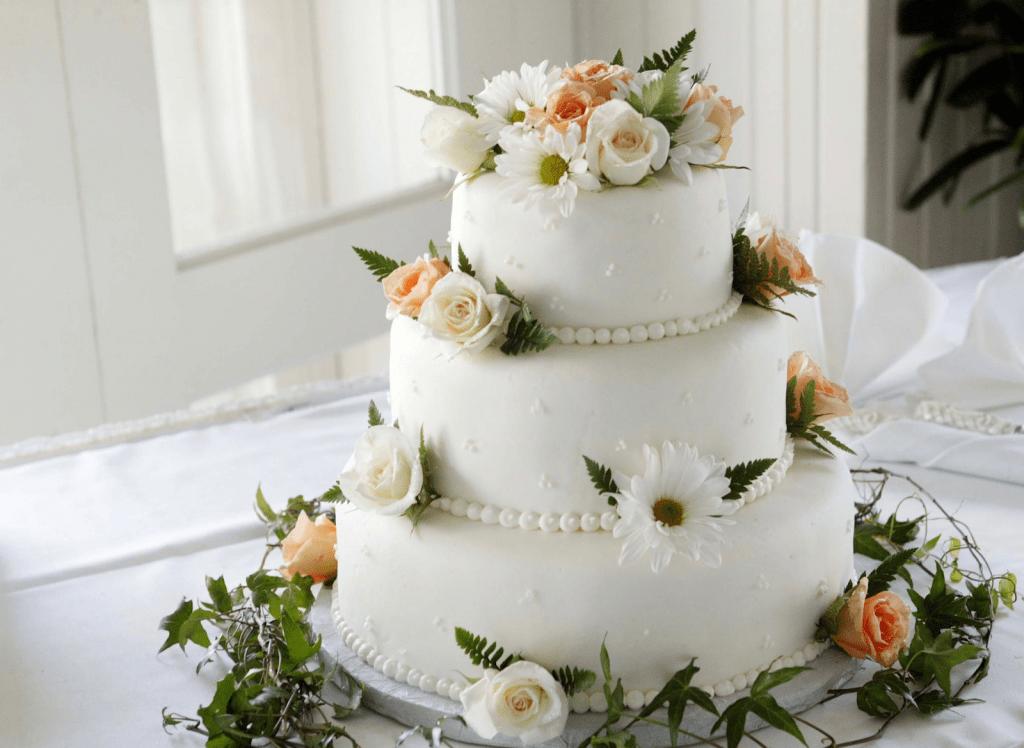 Wedding cake with peach flowers