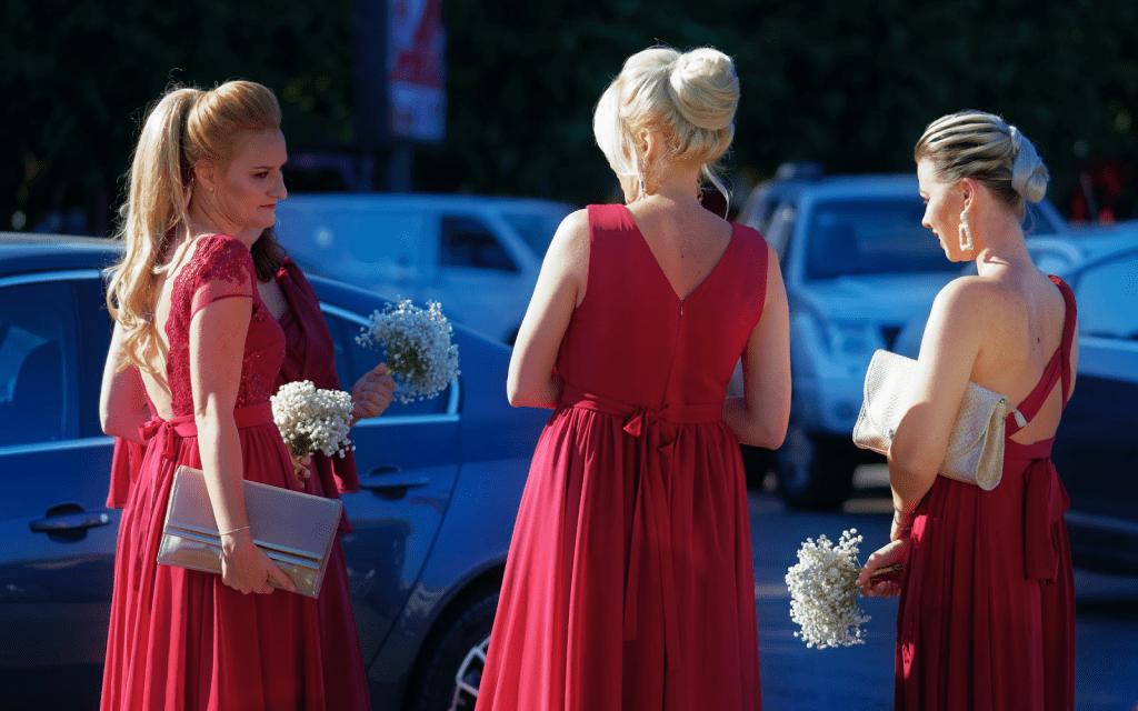 Bridesmaids in deep red dresses