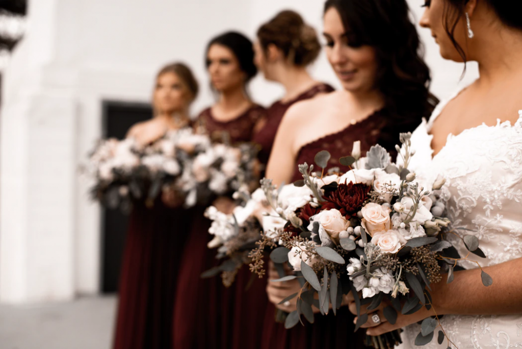 Bridal party in deep berry hues make for beautiful winter wedding colors