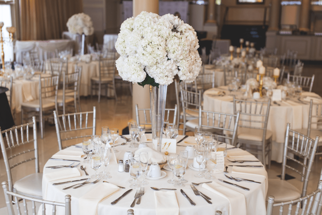 Wedding reception decor in white and metallic accents