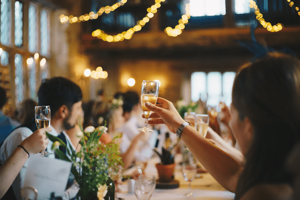 Guests raising a glass to toast