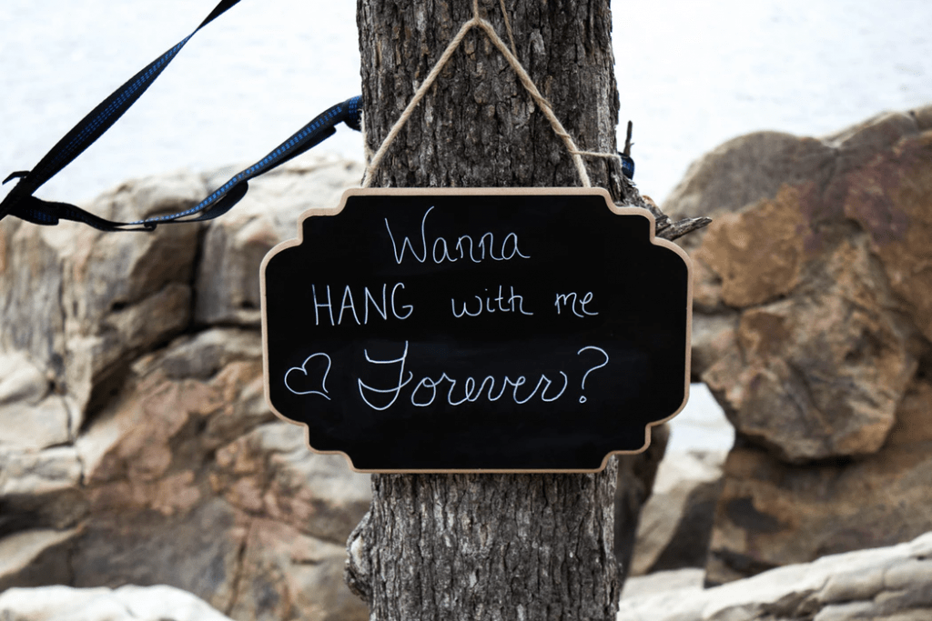 """Romantic ways to propose: Sign that says """"Wanna hang out with me forever?"""""""
