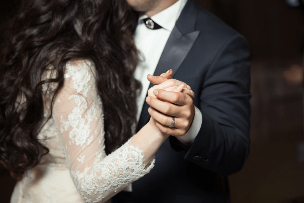 Married couple dancing hand-in-hand