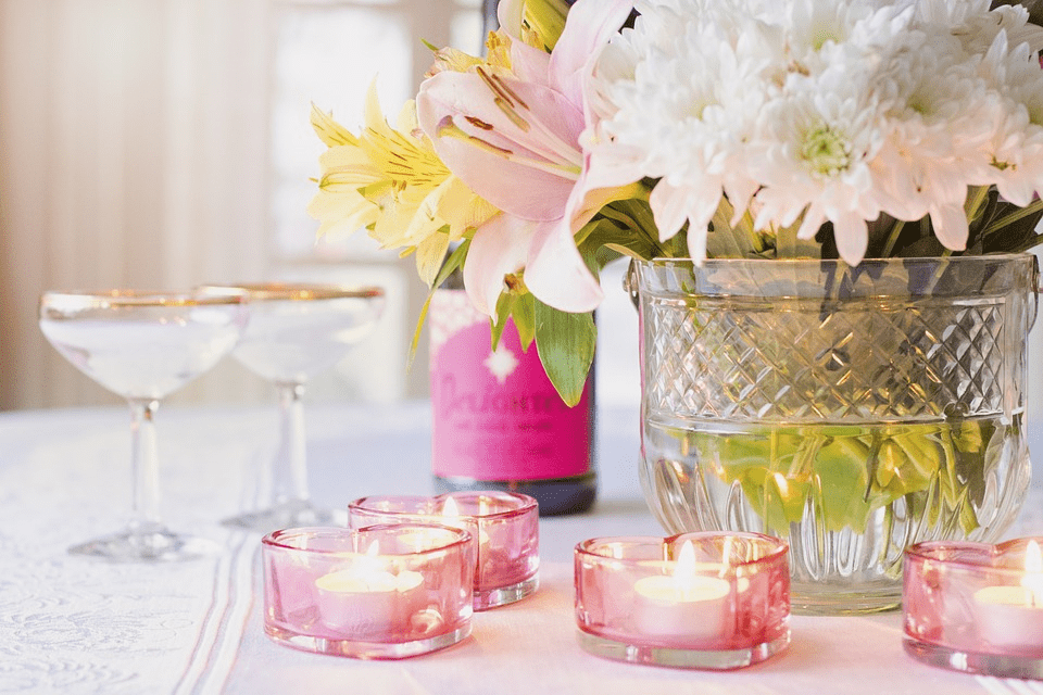 Bridal shower tablescape with pink glass tea lights and flowers