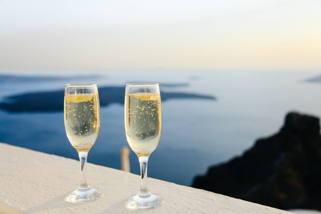 champagne flutes with ocean background
