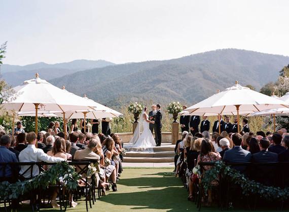 shaded ceremony umbrella summer wedding ideas